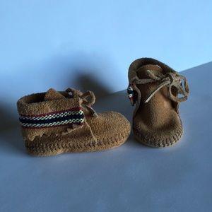 Minnetonka moccasins with braid trim
